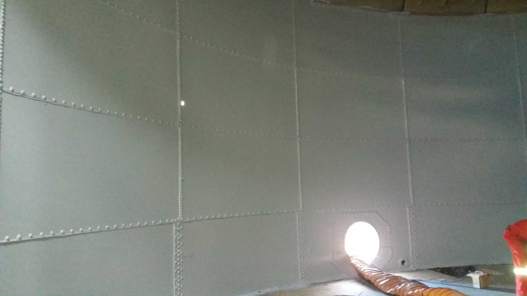 wastewater tank internal wall painted in white