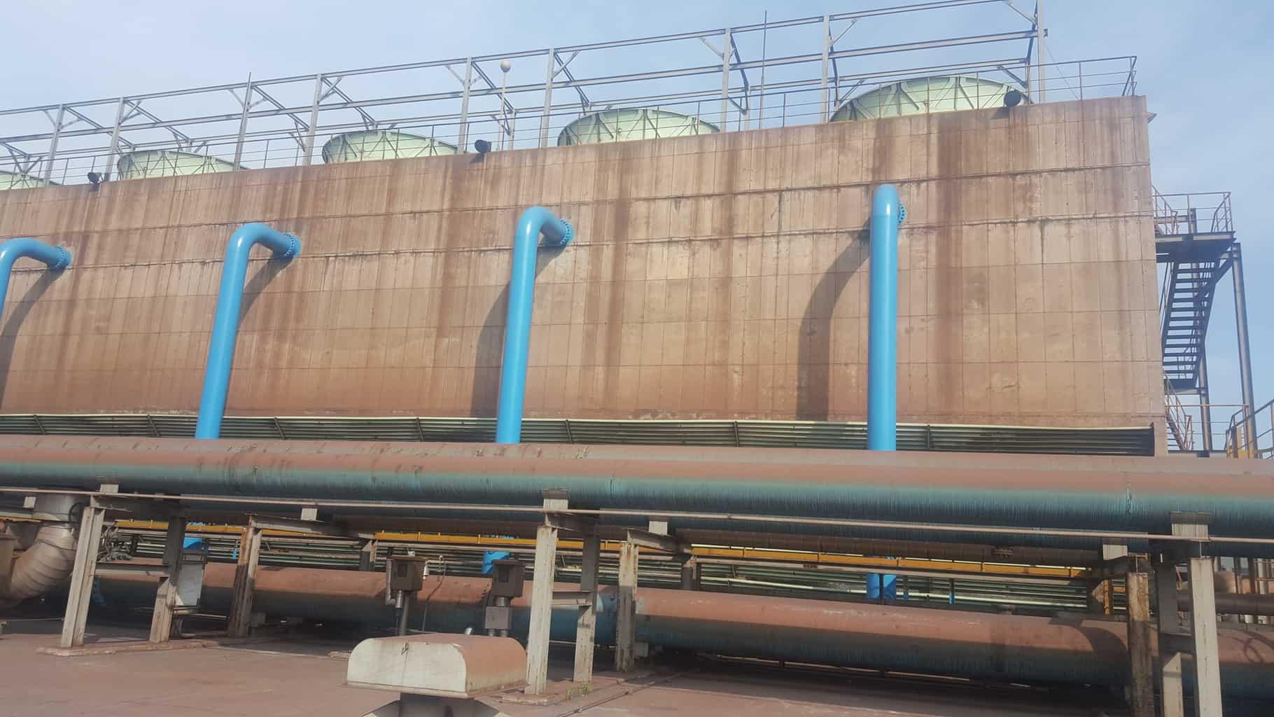 blue pipeline externals on large concrete building