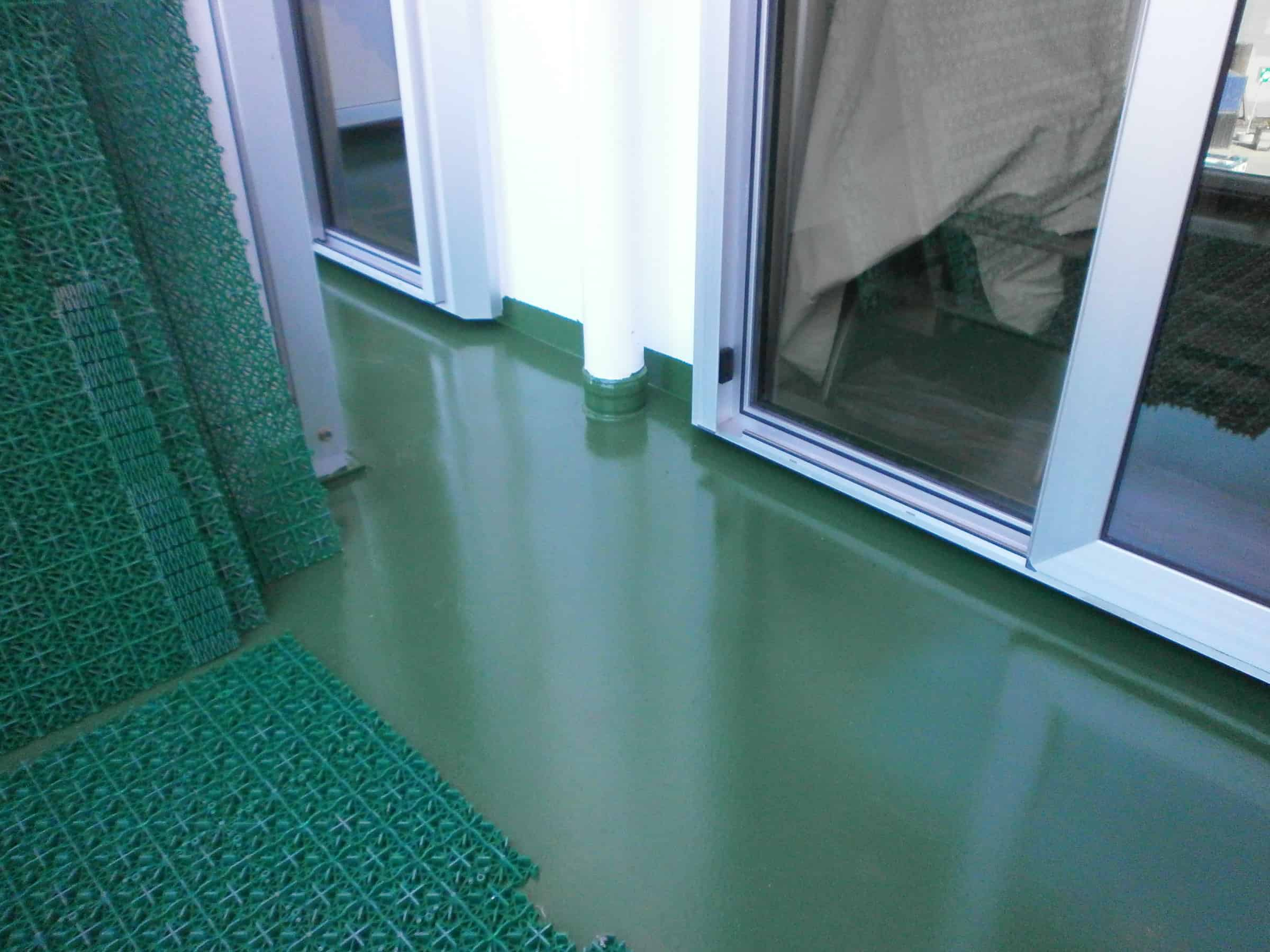 vessel balcony painted in dark green with white walls and sliding doors