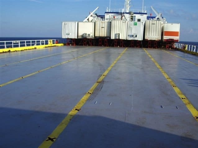 external blue decking with yellow stripes and containers