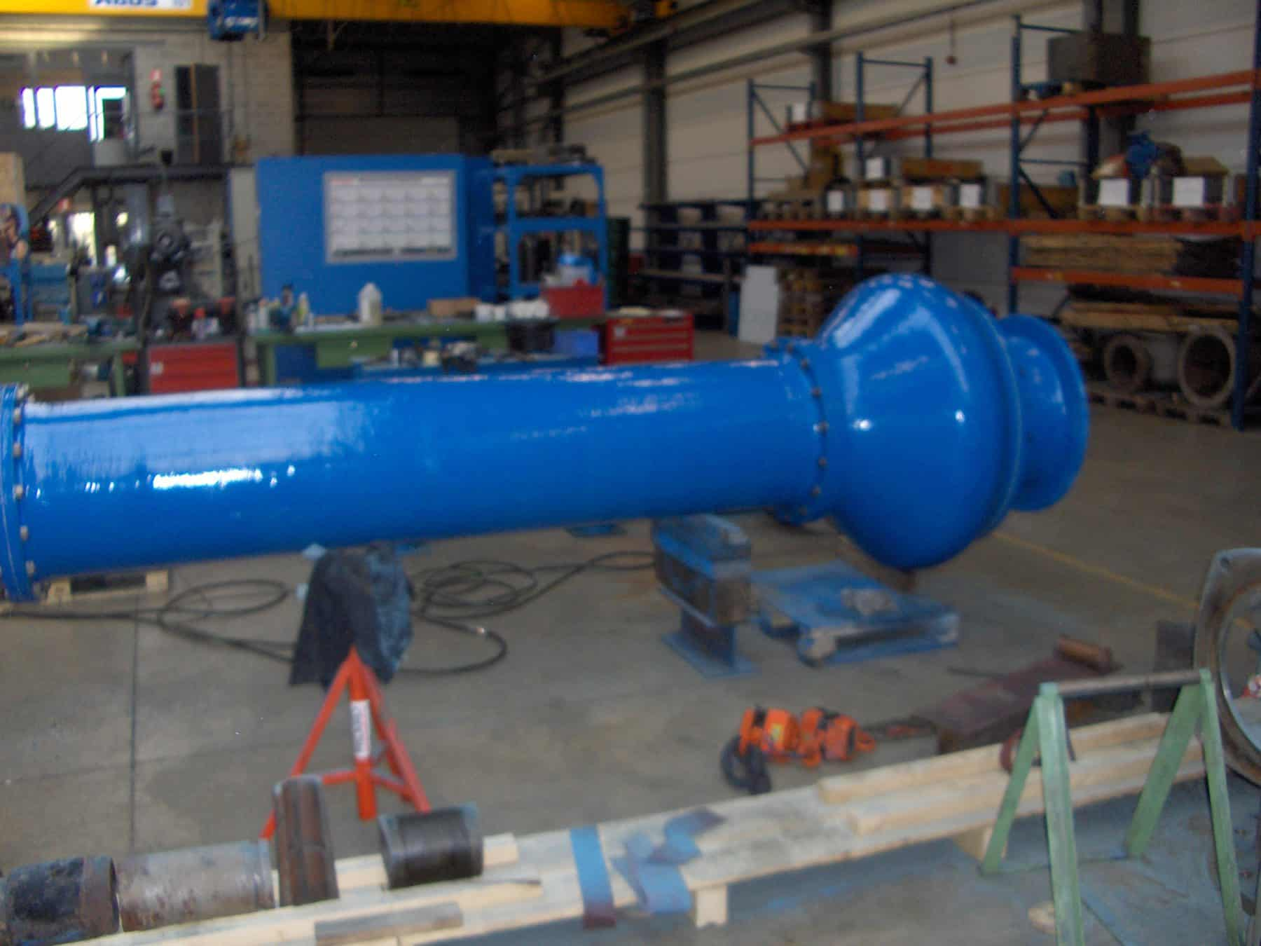cooling water pump painted in blue in workshop