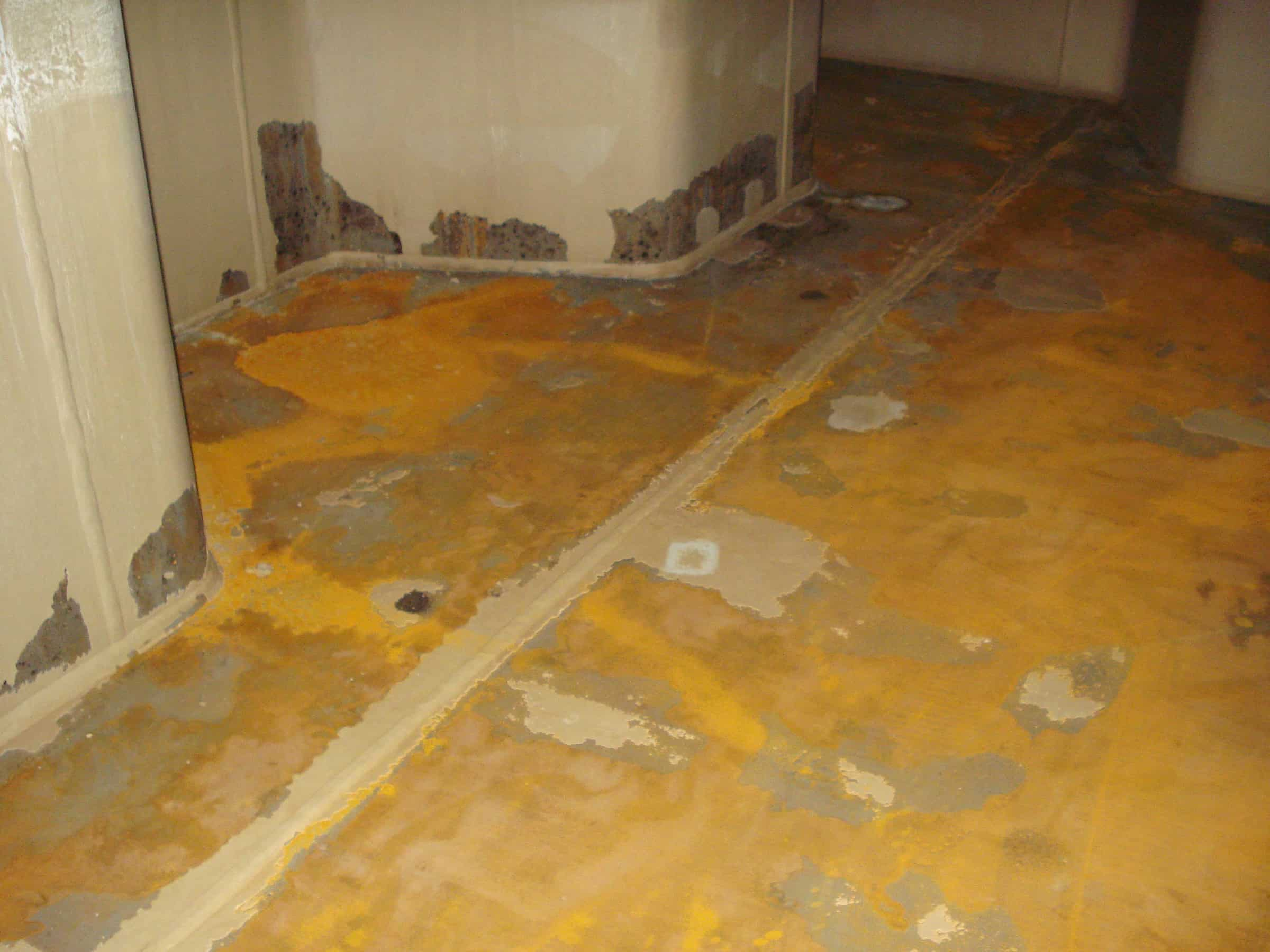 rusted chemical tank floor and walls