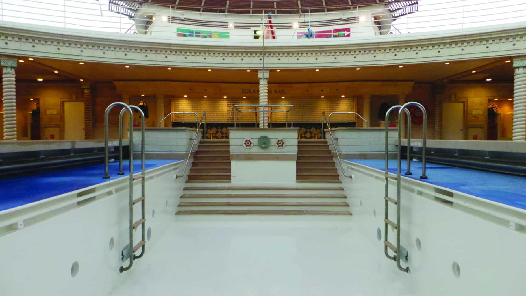 empty indoor cruise ship swimming pool