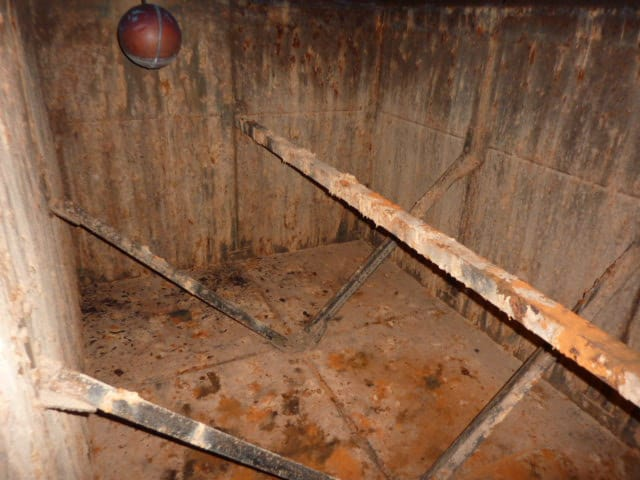 heavily rusted potable water tank internals