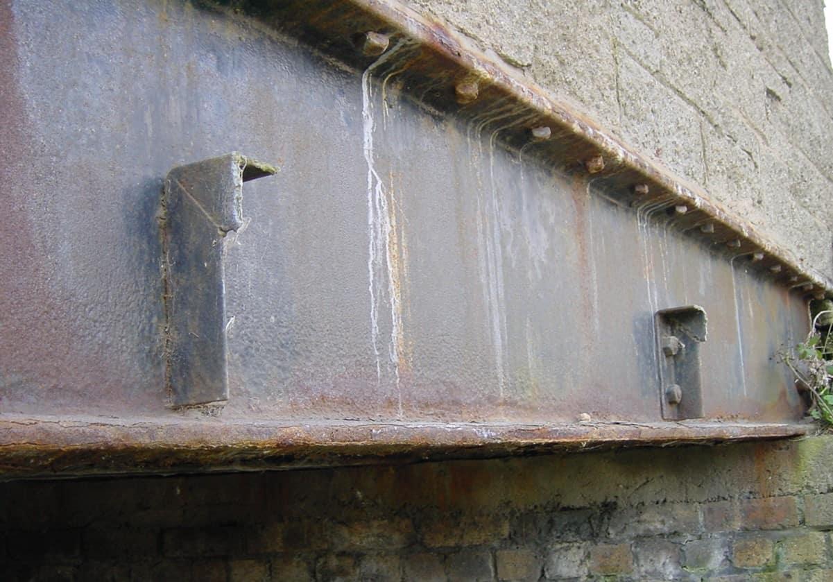 rusted horizontal bridge metal beam
