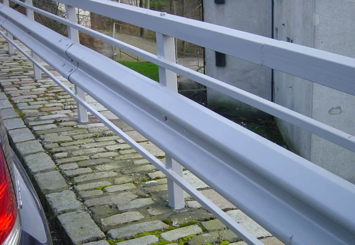 roadside safety barriers painted in grey