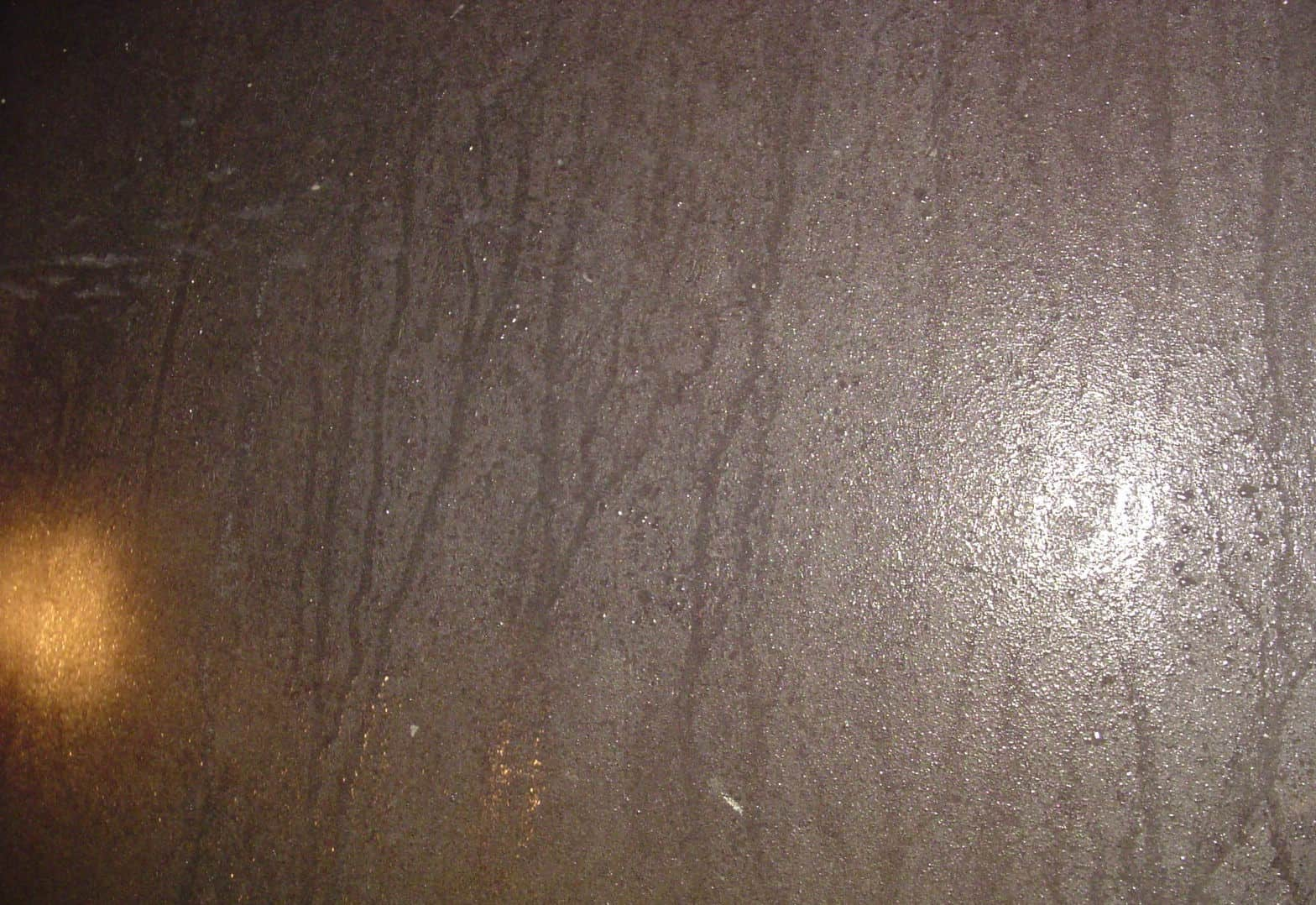 moisture lines on unpainted internal tank wall