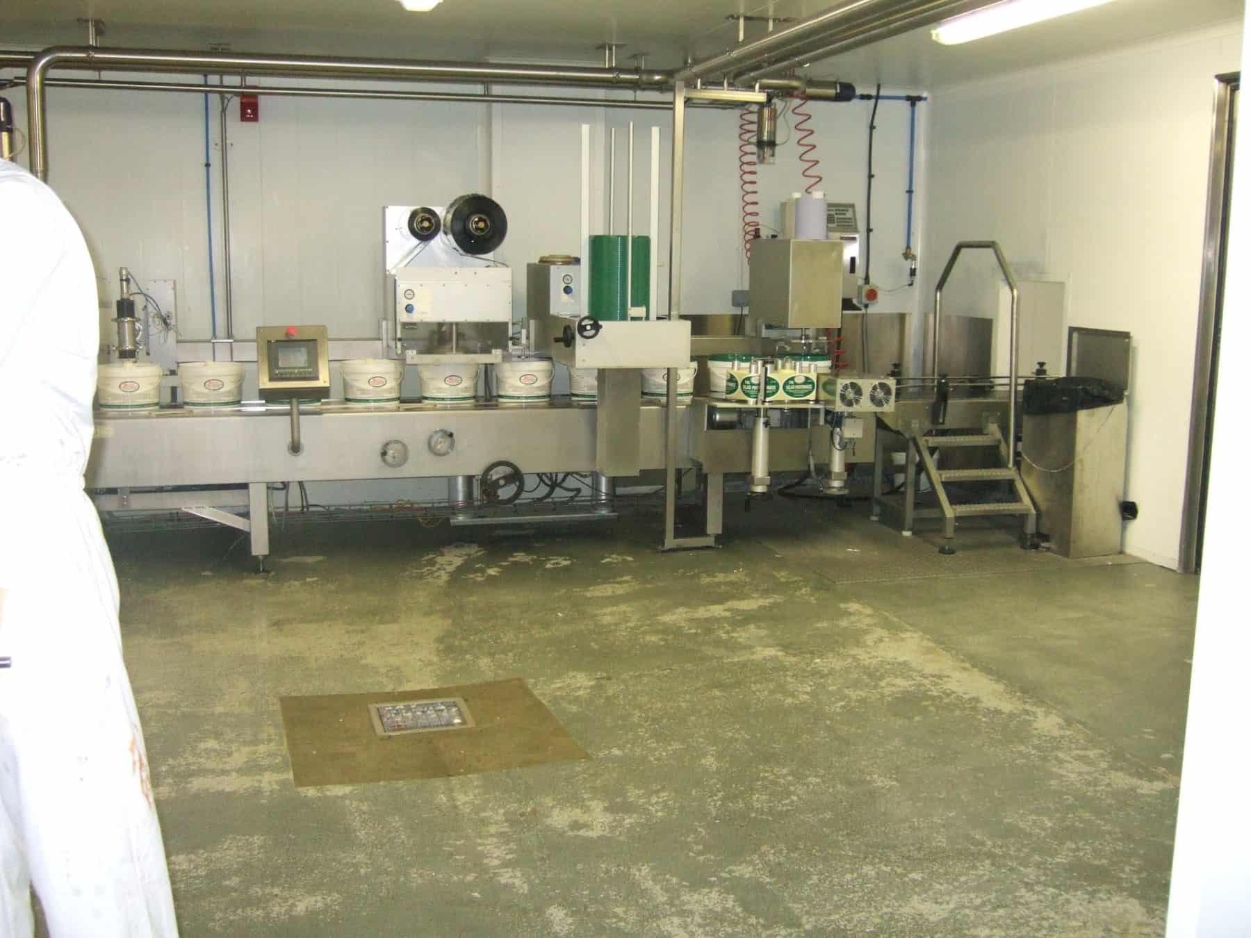 food factory room with unpainted flooring and machinery