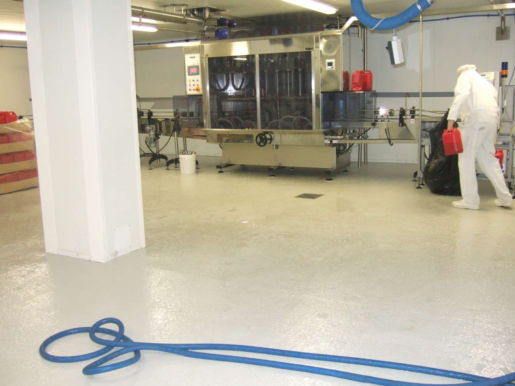 food factory room with white pillar, flooring and machinery