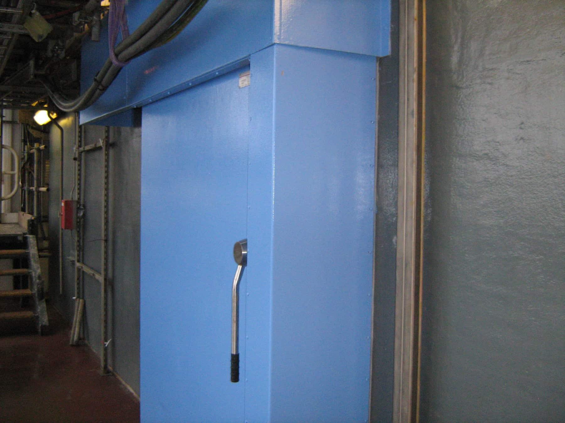 external door on offshore platform painted in blue