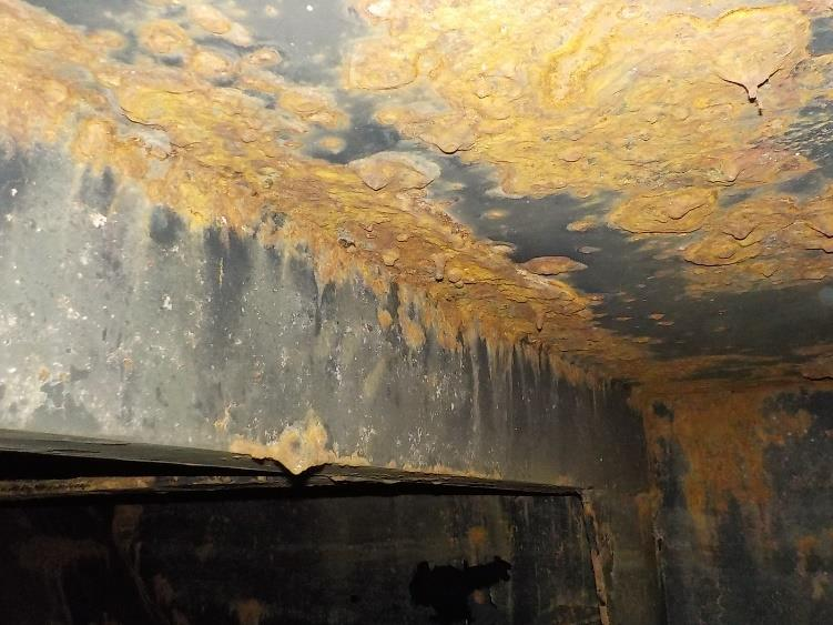 heavily rusted internal tank roof and walls
