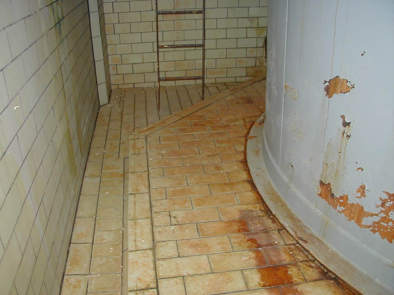 heavily rusted internal floor and bunded wall