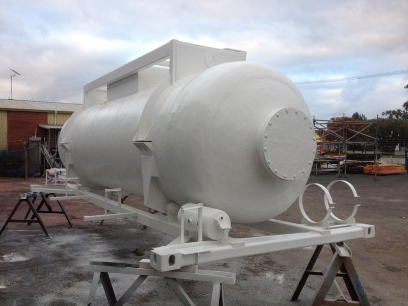 white tank external in factory yard
