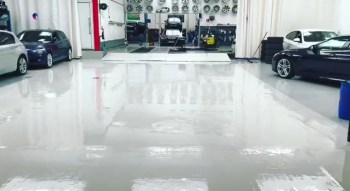 glossy white painted floor in car showroom
