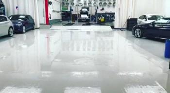 glossy white painted floor in car showroom