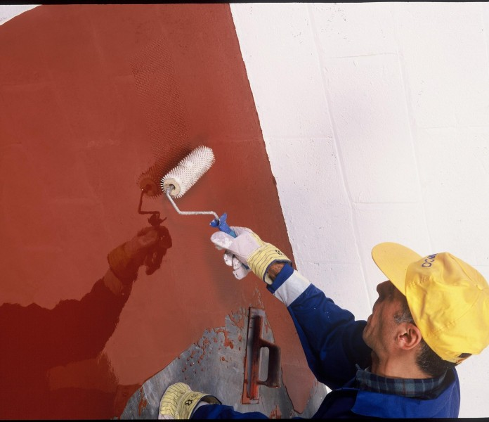 application of red paint to vessel flooring