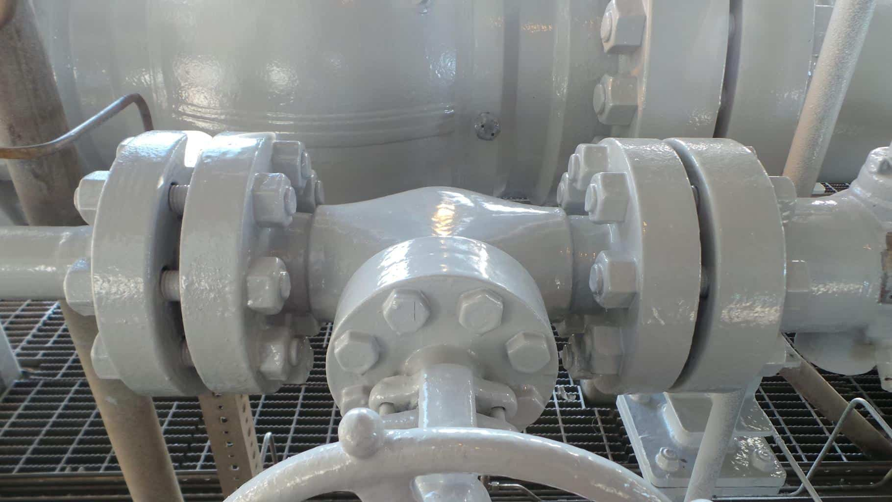 sweating pipeline refurbished in grey paint