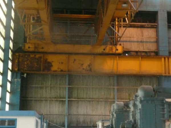 heavily rusted yellow wall panel in turbine hall