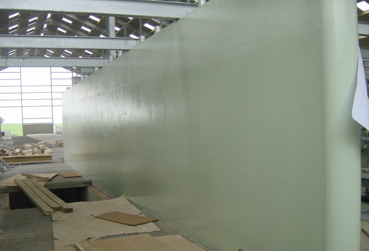 cream-painted production wall within farm shed
