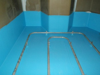 tank internals with blue floor, wall and piping
