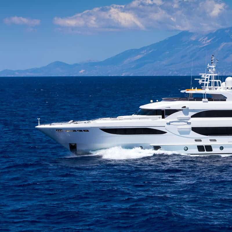 white yacht gliding through the ocean