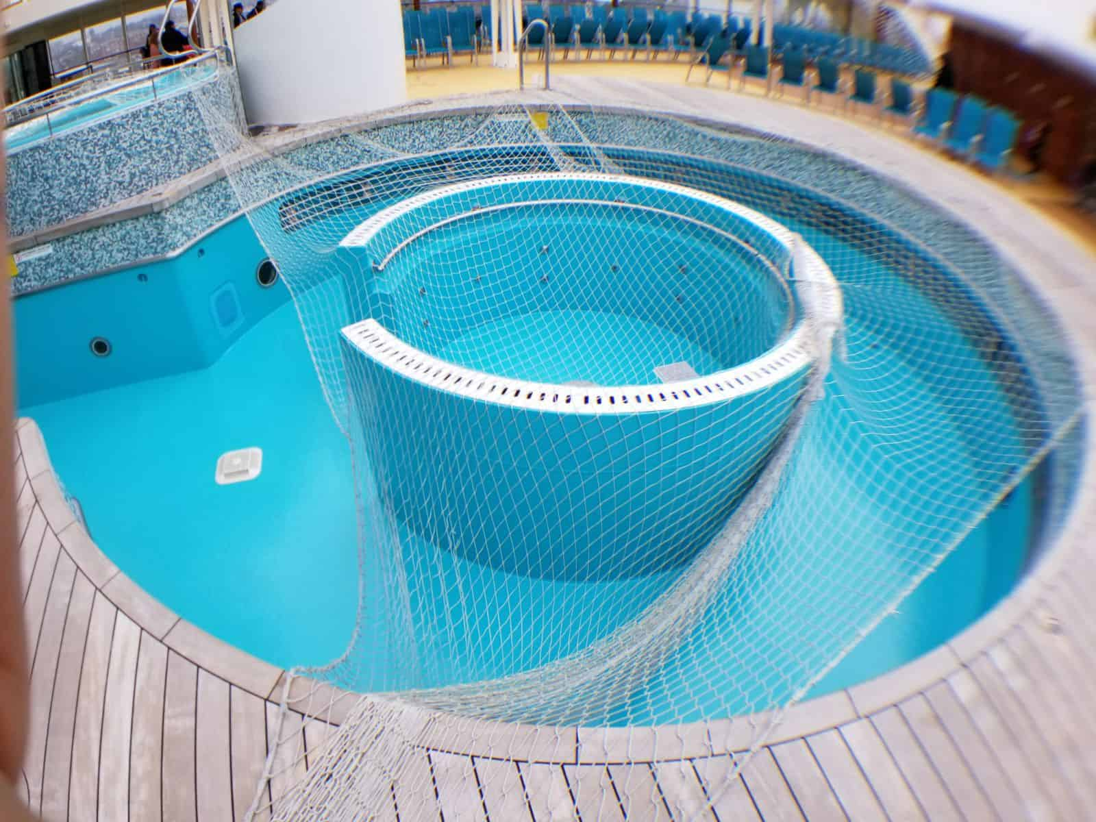 ship swimming pool painted in blue with protective netting