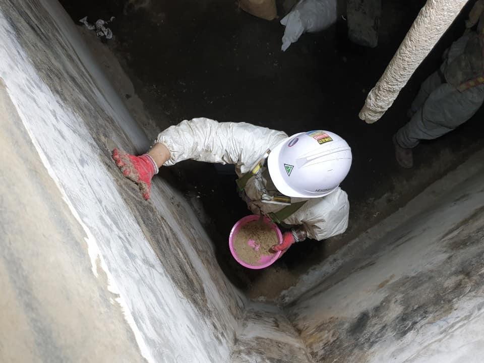 applicator repairing damaged wall crack repairs