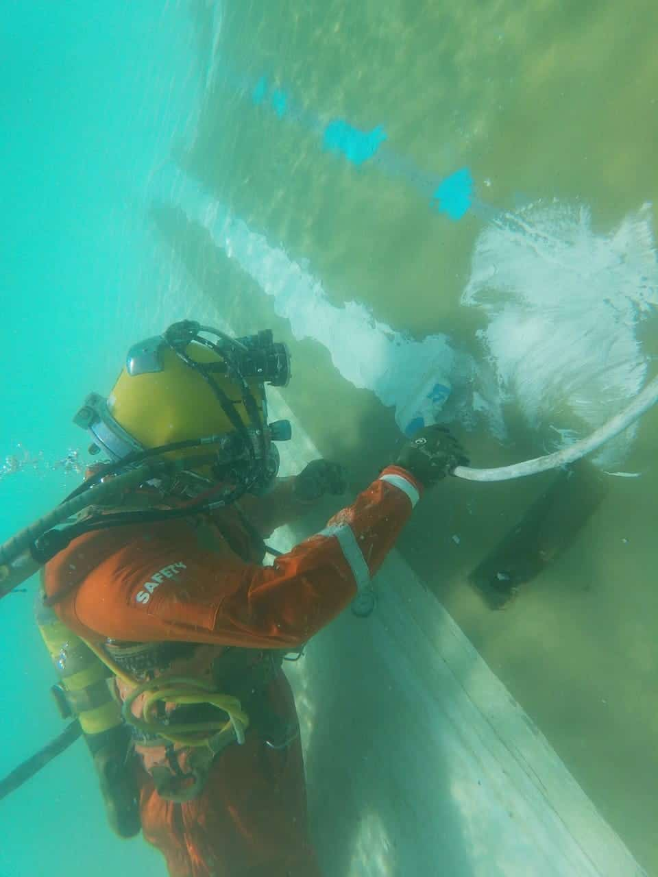 diver applying chemco coating to underwater substrate
