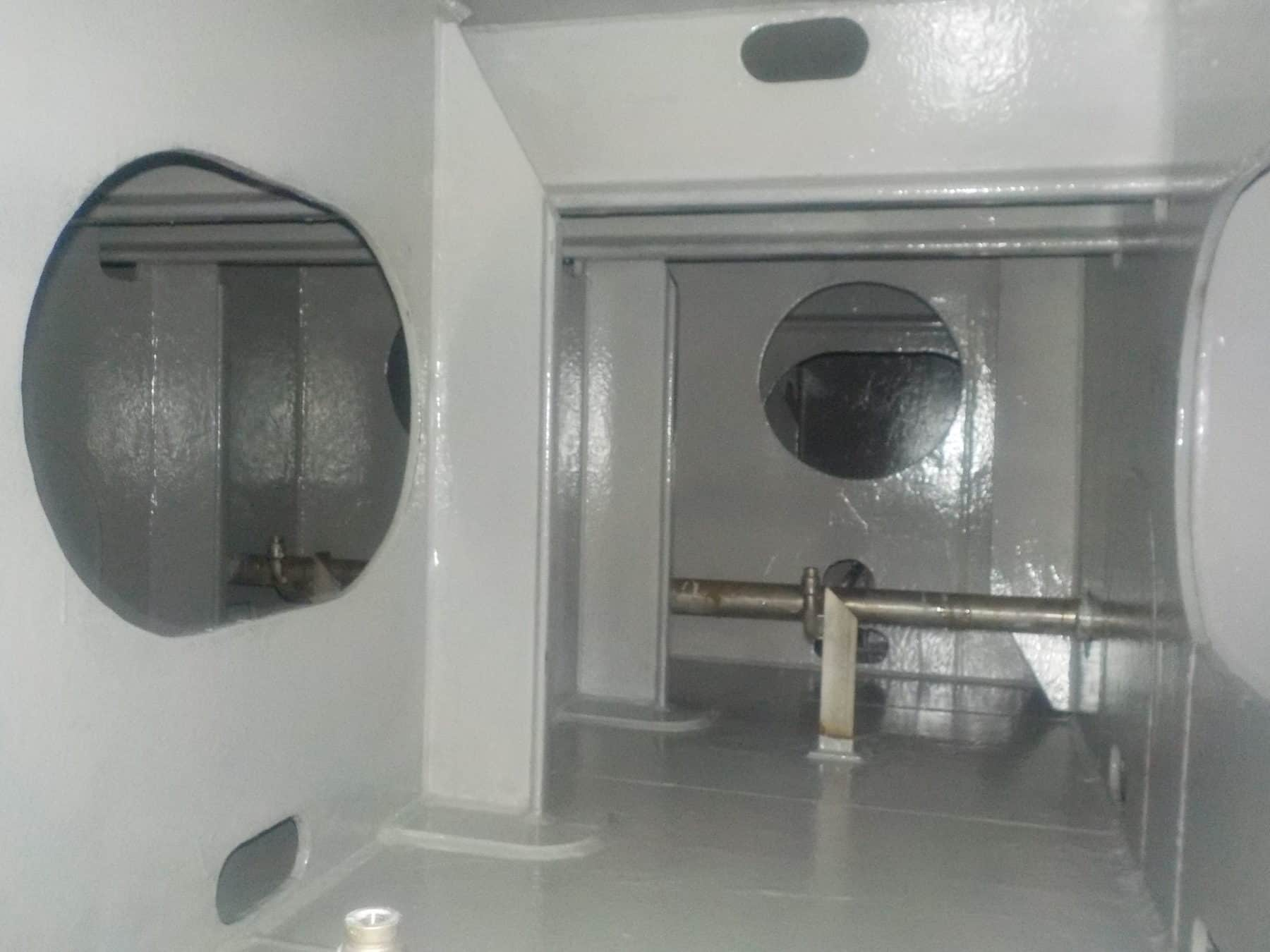 tank internals coated in grey paint